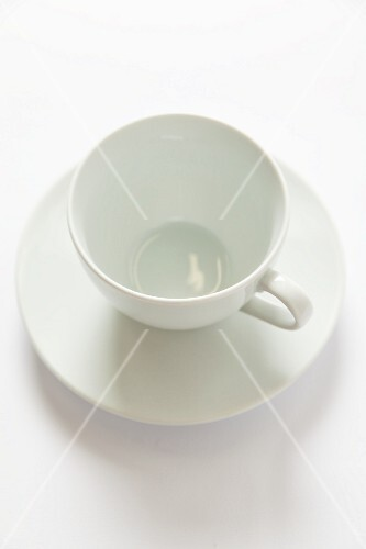 A white cup and saucer