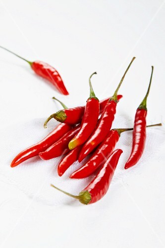 Several fresh red chillies