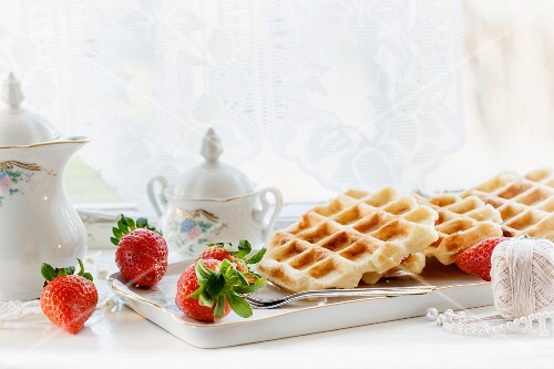Belgian waffles served with strawberries on a windowsill
