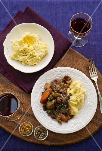 Beef stroganoff with mashed potatoes and red wine