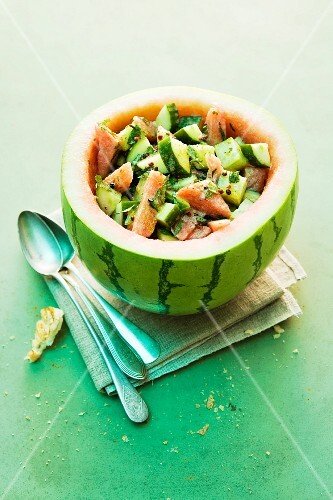 Cucumber and melon salad served in a hollowed out watermelon