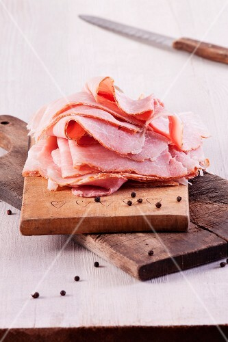 Slices of ham on a chopping board