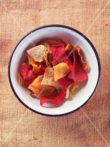 Colourful vegetable chips in a metal bowl