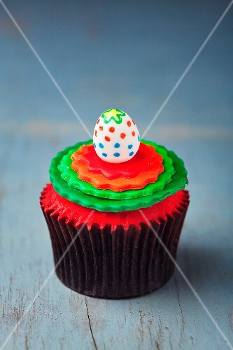 A colourfully decorated Easter cupcake