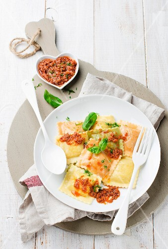Ravioli with a minced meat sauce and basil