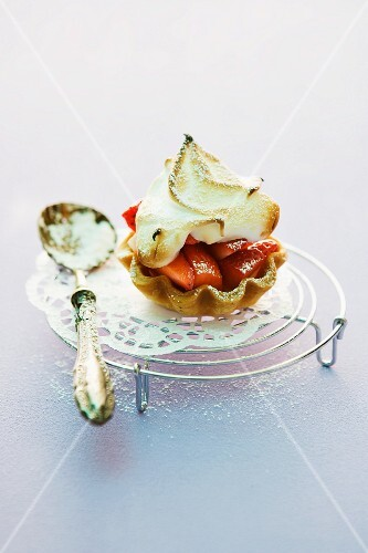 A strawberry tartlet topped meringue