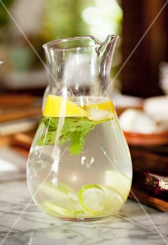 A jug of water with lemon