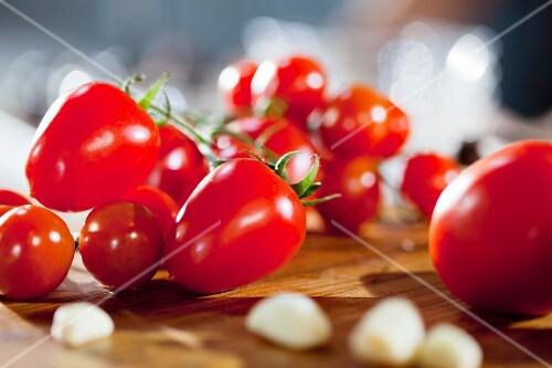 Cherry tomatoes on wooden board