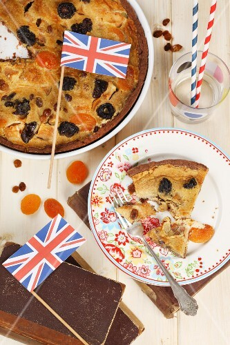 A dried fruit tart decorated with Union Jack flags