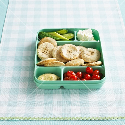 A lunch box filled with Greek ingredients