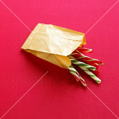 Candy canes in paper bag