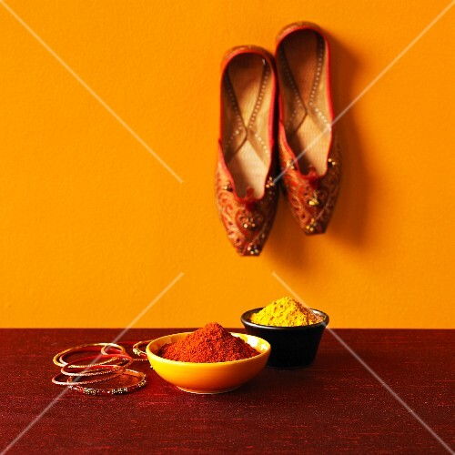 An arrangement featuring Indian spices, bangles and slippers