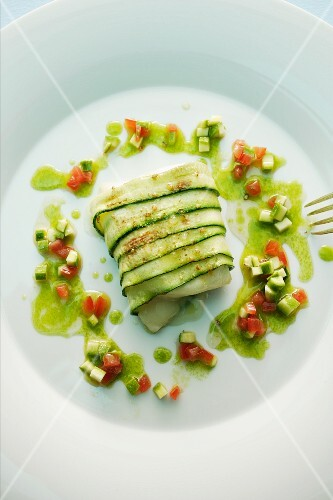 Roasted goat's cheese wrapped in courgette with a tomato and wild garlic vinaigrette