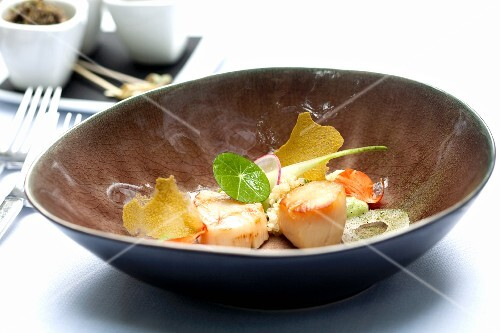 Fried scallops with nasturtiums