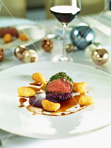 Beef fillet with a herb crust on a bed of red cabbage