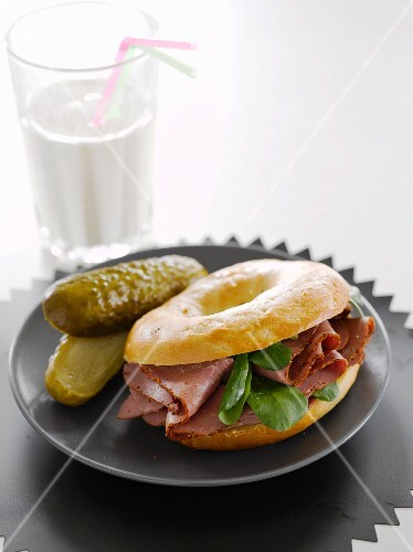 A pastrami and gherkin bagel