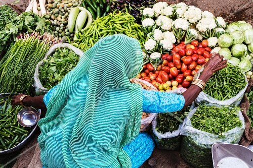 A vendor with vegetables at a market (Jaisalmer, Rajasthan, India)