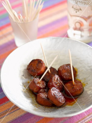 Grilled chorizo slices on sticks
