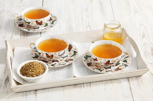 Meadowsweet tea and dried tealeaves