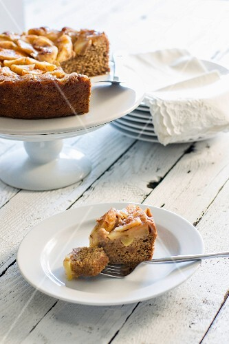 Apple cake on a cake stand, sliced