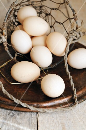 Organic eggs in a wire basket
