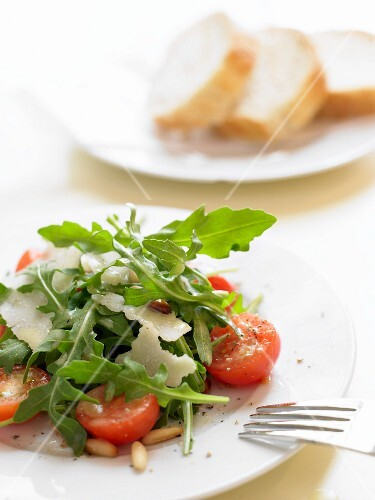Rocket and tomato salad with Parmesan and pine nuts