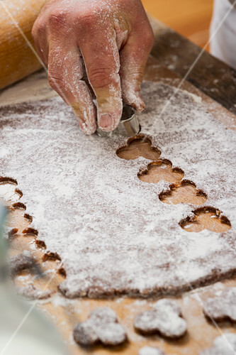 A confectioner cutting out biscuits