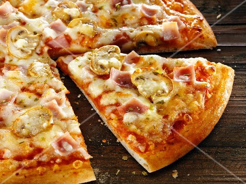 Ham and mushroom pizza, sliced
