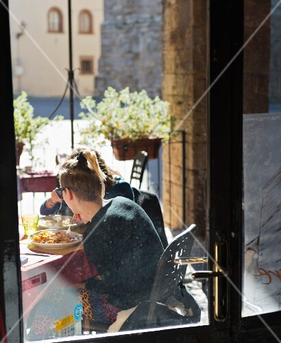 People in a restaurant in Massa Marittima (Tuscany, Italy)
