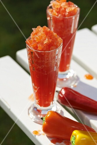 Pepper granita in sundae glasses with various pointed peppers