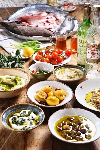 Mazet – Middle Eastern breakfast featuring olives, salted lemons, hummus, tahini, aubergine, red mullet and arak