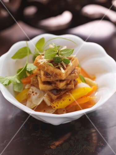 Fried spiced tofu on marinated root vegetables (Asia)