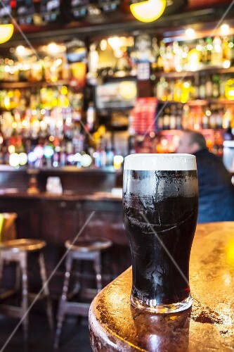 A freshly drawn pint of Guinness on a bar in a pub