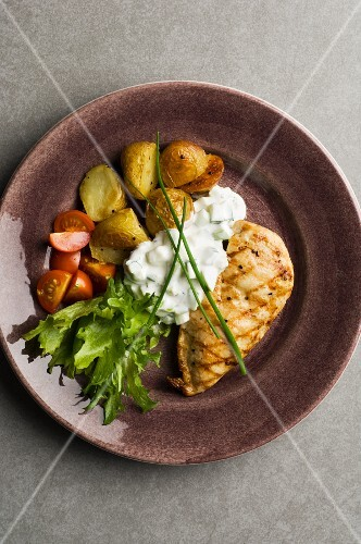 Chicken breast with roast potatoes and quark