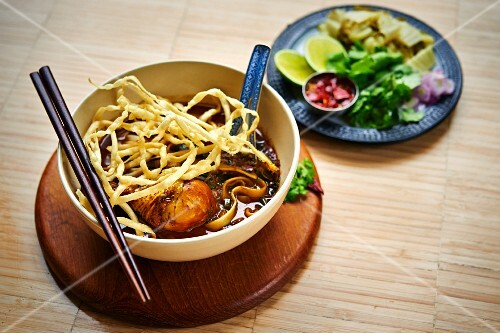 Khao Soi - crispy fried egg noodles with shallots and meat curry (Asia)