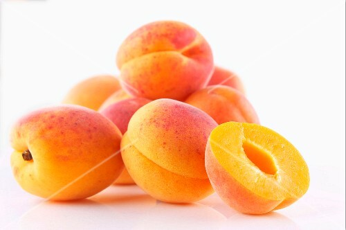 Fresh apricots, whole and halved
