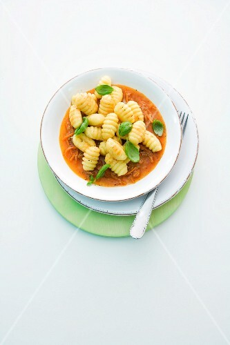 Gnocchi with tuna sauce and basil