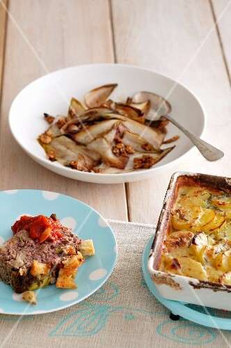 Meat loaf with croutons served with potato gratin and a fennel medley