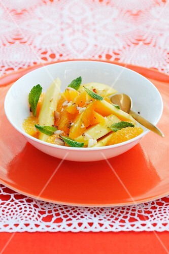 Fruit salad with nuts and mint