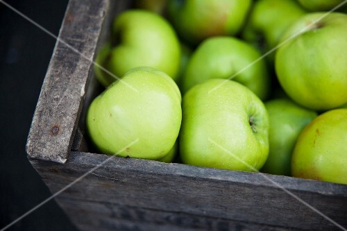 A crate of Granny Smith apples at a market in East London