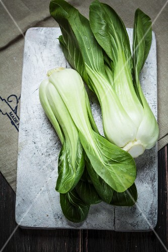 Bok choy on a chopping board