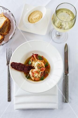 Seafood soup with bread and wine