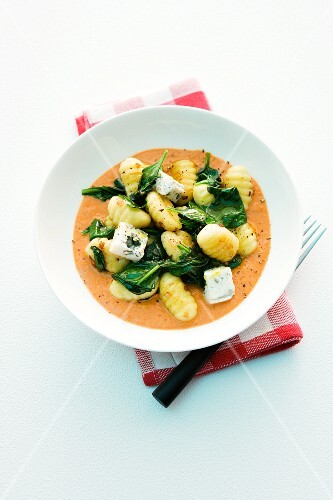 Gnocchi with gorgonzola and spinach in tomato sauce