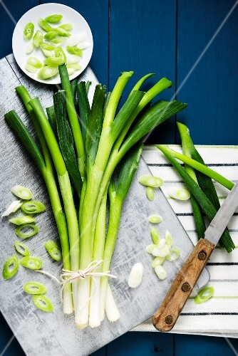 Fresh spring onions, some sliced