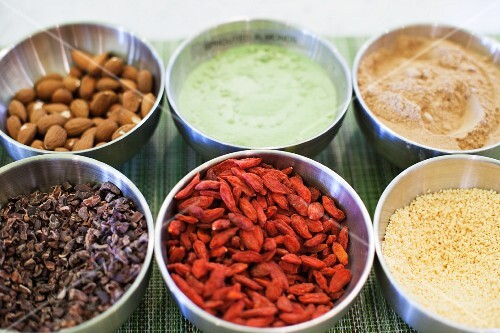 Bowls of various ingredients (almonds, spices, goji berries, couscous)
