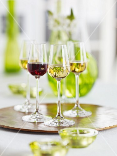 Red wine and white wine in shot glasses