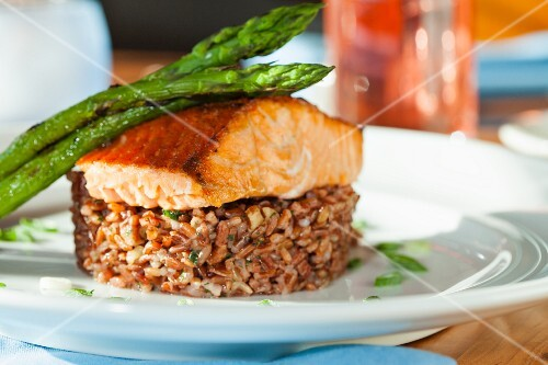 Salmon fillet with green asparagus on a bed of rice