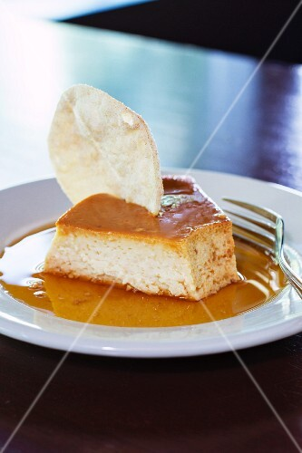 A slice of cake in caramel sauce