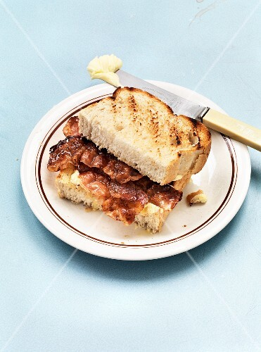 A toasted sandwich with bacon and butter