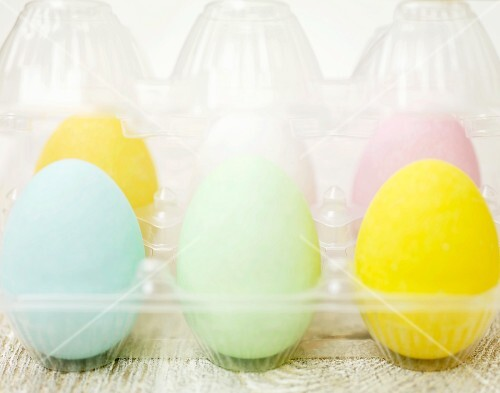 Pastel coloured Easter eggs in a plastic container